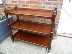 Antiques Buffets, Victorian Mahogany Buffet Or Server. Victorian mahogany 3 tier dumbwaiter, buffet or serving table, good figured mahogany having raised gallery to each shelf, turned and reeded supports w Antique Buffet, Serving Table, Vintage Items, Shelf, Victorian, Desk, Antiques, Gallery, Furniture