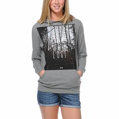 """Take a trip to nowhere in the Lets Get Lost Glamour Kills hoodie! With an adjustable drawstring hood, kangaroo front pocket, long sleeves, and soft fleece interior, this heather grey sweatshirt is ready for anything you can handle. Featuring a dark forest photograph with """"Lets Get Lost"""" lettering, this girls GLMR KLLS hoodie looks great with denim shorts and adventures."""