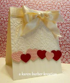 simple; nice use of embossing on background and hearts; add colored ribbon or baker's twine and put anniversary or Valentine message at the bottom of card front