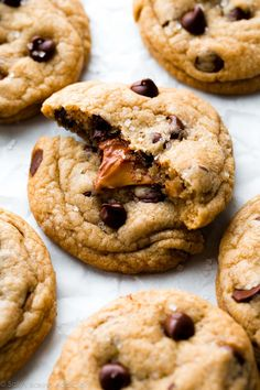 How to make Salted Caramel Chocolate Chip Cookies! These are unbelievable and disappear every time I make them! Recipe on sallysbakingaddiction.com