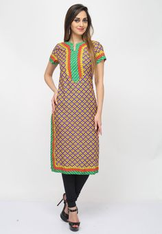 Appeal to your refine taste with this Violet-Yellow #Color Cotton #DesignerKurti which is adorned with intriguing prints and patched yoke and border.