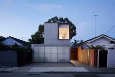 concrete melbourne home by jackson clements burrows integrates perforated shutters