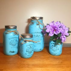 """This robin egg blue 4 piece painted mason jar kitchen gift set, complete with flower vase, adds the perfect rustic charm to your kitchen. Our unique colours add a gorgeous pop of colour to your home and pull their weight when organizing your kitchen items. The lids are covered in a beautiful jute/burlap fabric.     PLUS: Short on time? Choose to receive the set pre-gift wrapped! Just select """"gift wrapped"""" in the drop down menu. No other mason jar listing includes this much value…"""