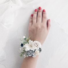 White Flower wrist corsage, Grey flower Bridesmaids corsage in 2019 Prom Corsage And Boutonniere, Bridesmaid Corsage, Bridesmaid Flowers, Flower Bouquet Wedding, Wrist Corsage Wedding, White Corsage, Flower Corsage, Dark Blue Flowers, Exotic Flowers