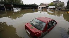 Vehicle are partially submerged in flood waters in Srinagar, India, Sunday, Sept.7, 2014