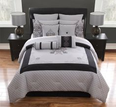 """10 Piece Cal King Felicity Black and Gray Comforter Set by KingLinen. $99.99. Give your bedroom a makeover with this beautiful bedding set. Classic floral embroidery in the center with leaf scrolls at the corners and quilted borders for an exquisite look .4 decorative pillows and bonus euro shams included. FeaturesColor: Black/GraySize: California KingMachine washable Matching curtains availableThis set includes:1 Comforter (104""""x90"""")2 Shams (20""""x36""""+3"""")1 Bedskir..."""