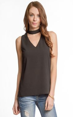 key hole top from everscollective boutique. Shown in black key hole top choker top trendy chic work wear