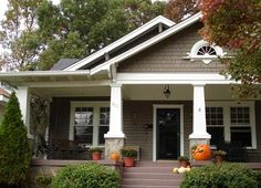 Love this!...the style, the color, the porch! Would love to see the inside..