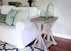 A simple farmhouse end table with sturdy X supports on both sides plus a lower…
