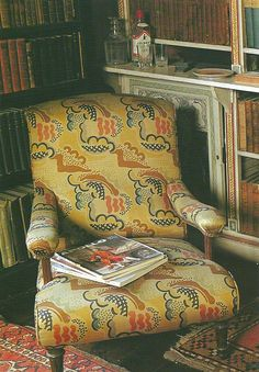 chair in the library at charleston, in 'clouds' fabric by Duncan Grant.