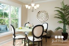 Clean and contemporary dining room with circle mirror decor, Queen Anne chairs, maple floors and a pedestal table. They added a white chandelier. See other lighting styles they could have bought by clicking on the pin. #lighting #contemporary
