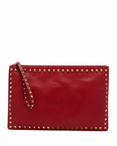 Rockstud Zip Clutch, Red by Valentino at Bergdorf Goodman.