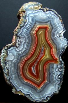 Agate - Agate is one of the world's most common stones, but don't let its common occurrence lead you to believe it is anything less than special!  This little gem is found all over the world.  The main areas include Africa, Asia, Brazil, Egypt, Germany, India, Italy, Mexico, Nepal, and the USA.  The name Agate comes from the river Achetes in Sicily, where it was first noted in ancient times.  Agates have been discovered with Neolithic artifacts and were used before 3000 BC.  No doubt, it is because of their rich colors and striking beauty that they were used for jewelry making in ancient India.
