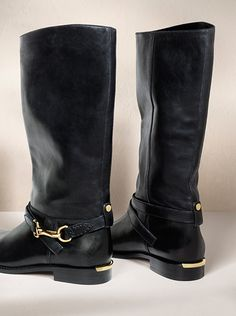 Smooth leather riding boots with polished metal buckle from Burberry for Spring/Summer 2014