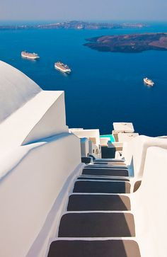 I wish I could stand at the top of these steps to the sea . Greece