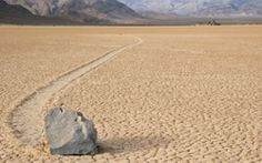 For six decades, observers have been confounded by the movement of large rocks across a dry lake bed in California's Death Valley National Park. Leaving flat trails behind them, rocks that weigh up to 100 pounds seemingly do Michael Jackson's moonwalk across the valley's sere, cracked surface, sometimes traveling more than 100 yards. Without a body of water to pick them up and move them, the rocks at Racetrack Playa, a flat space between the valley's high cliffs, have been the subject of…
