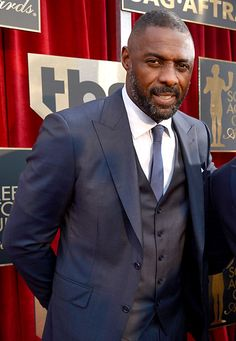 BEST: Idris Elba Mark Twain once said that clothes make the man, but in this case, Idris Elba's swagger makes this suit an absolute standout. Looking incredibly sexy and sophisticated in Zenga, Elba — a double winner on the night — could have also won an award for this look too. #SAGAwards