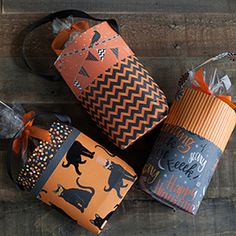 Make these DIY Halloween Goodie Bags, and fill them with treats. Grab your favorite stack of patterned scrapbook paper and fold the sheets into adorable Halloween treat bags. Diy Halloween Goodie Bags, Halloween Class Party, Pretty Halloween, Halloween Goodies, Halloween Items, Halloween Crafts For Kids, Easy Halloween, Halloween Treats, Paper Halloween