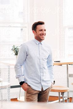 Confident Portrait of businessman entrepreneur at work in stylish startup company