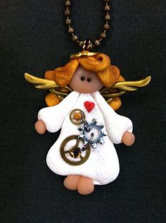*POLYMER CLAY ~ Steampunk Blond Angel Necklace; I'd use this as an ornament