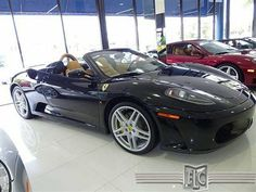 Buy or bid this 2007 Ferrari F430 F1 Spider, visit: http://www.ftlauderdalecollection.com/detail-2007-ferrari-f430_spider-2dr_convertible_spider-used-10964132.html The 2007 Ferrari F430 F1 Spider is powered by a 483hp V8 and this car represents all that is desirable in a Ferrari. This is a really sharp car with a great black-and-tan color combination and some extra interior trim options like Daytona seats and Daytona rear wall with interior-color roll bars. Very tastefully done.