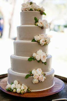 elegant 5-tiered wedding cake with ivory roses