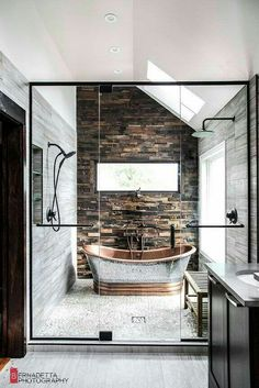 A rustic and modern bathroom () Magda of Euro Style Interior Design based in Chicago sent along some photos of a bathroom design she recently completed and it is stunning! Such incredible, warm textures. The scoop: My clients wanted