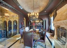 Formal Dining Room, Chateau-style mansion, Southlake, Texas - note the glass wall at left, beyond which are stairs down into the Wine Cellar...