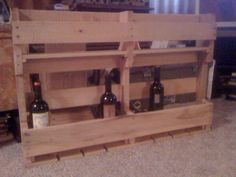 """I saw an interior design segment on GMA a month or two ago where they showed a pallet turned wine rack; I shared the link with my boyfriend. He said """"I can do that."""" And he did for my birthday. Love it. I can't wait to get it on the wall with my wine glasses hanging from the bottom."""