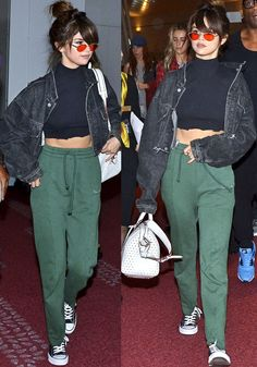 Selena arrives at Tokyo in a pair of $665 sweatpants from Vetements