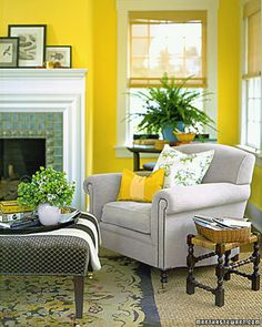 Color Plus Yellow  Dandelion-yellow walls and clean white woodwork pull this room's architecture together. Crisp black-and-white engravings -- photos work, too -- and the snap of several blues combine to make yellow (almost) a neutral background.
