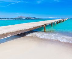 Long white sandy beaches, shallow clear waters and a gentle relaxing breeze at Platja de Muro in Alcudia, Mallorca.