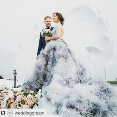What an amazing gown!  @weddingdream  Perfect for grandeur weddings this gown by @katesofficial is such a stunner! The grey palette and feather-like train works perfectly well together in creating a lavish and sophisticated design like this. Who loves this as much as we do? Tap tap!