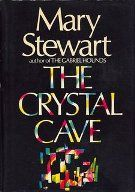 The Crystal Cave - first book of her Merlin series. It is followed by The Hollow Hills, The Last Enchantment and The Wicked Day. Great books!