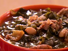 Sausage, White Bean, and Swiss Chard Soup from FoodNetwork.com - so good with some variation:     -I substituted 1 bag of pre-chopped escarole for swiss chard since that was what was in the store  -used 2 lbs of sausage  - 4 cloves of garlic  - did not rinse or drain the beans  - fried onions and garlic first in oil then added sausage