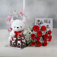 Adorable and delightful, this is a hamper of red roses in bunch, a round black forest flavored cake, and a cute white teddy bear that are all set to brighten your loved ones' face with smile. Christmas Is Coming, Christmas Time, Christmas Gifts, Online Gift Store, Online Gifts, Teddy Bear Online, Send Flowers Online, White Teddy Bear, Christmas Hamper
