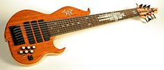 A custom-made 8 string Conklin Bass made with a Swamp Ash body and Bubinga top for the NYC band, You Bred Raptors?