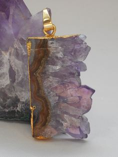 """Handmade Amethyst Specimen pendant is truly one-of-a-kind, set in 925-hallmarked sterling silver. Total Pendant Length: 2"""" including Bail. Width: .9"""""""