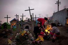 Day of the dead: People gather around the gravesat the Virgen de Lourdes cemetery