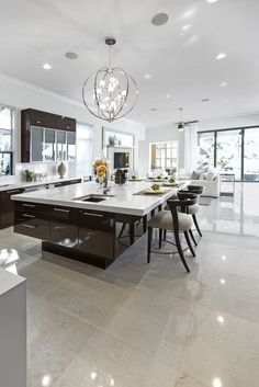❤Large modern white and dark brown kitchen with huge modern island with breakfast bar.