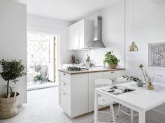 white kitchen - drawers at end of L-shape run