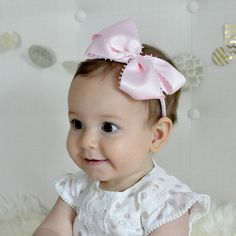 """A gorgeous satin bow for weddings, baptisms, special occasions and celebrations, will fit infants, toddlers and girls up to 6 yrs. - Large bow measures approx 4.5"""" - Available Colors: Pink, White, Lav"""