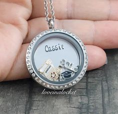 The perfect high school or college graduation gift! A beautiful floating locket necklace with hand stamped plate. Made with love just for her.  #graduationlocket #graduationnecklace #graduationjewelry #graduationgift #highschoolgraduationgift #daughtergraduationgift #daughtergraduationpresent #giftsforgrads  #floatinglocket #personalizedlocket #handstampedlocket #gradnecklace #handstampednecklace #openhousegift #handstampedjewelry