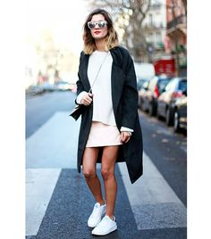 @Who What Wear - Anne-Laure of Adenorah  Sexy Scale: Light ​The French do sexy well, which is why we turned to blogger Anne-Laure for style advice. Her Choies coat paired with a Forever 21 sweater and skirt looked ultra-chic, especially when accessorized with bold HM sunglasses and sporty Stan Smith shoes.
