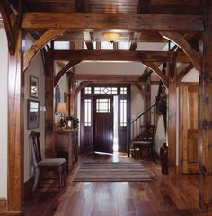 It's as if the entryway frames and welcomes those who enter the door, drawing each person further into the warmth of the whites and wood.