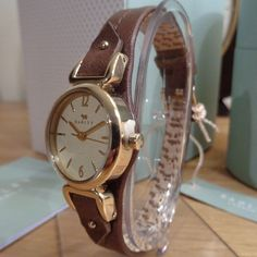 Radley RY2316 'Grosvenor' - Gold Plated Oval Dial Brown Leather Strap Watch - RRP £95 Another exceptional analogue ladies wrist watch by Radley, the oval dial makes an interesting difference in your watch wardrobe. A tan leather bracelet watch with gold plated features throughout set within a 22mm oval case that compliments the champagne dial. The stirrup shoulders that link it to the stitched brown leather strap give this watch a sophisticated equine feel. As with all Radley watches, the…