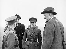 Hugh Dalton, right, Minister of Economic Warfare, and Colin Gubbins, chief of SOE, talking to a Czech officer during a visit to Czech troops near Leamington Spa, Warwickshire