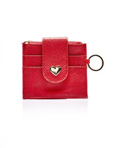 <p>This ID holder features a faux leather body with a zipper pouch compartment, two front card slots, back ID slot, front metal heart detail, and metal key ring clip.</p>  <ul> <li>Man Made Materials / Metal</li> <li>Imported</li> </ul>