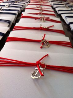 envelope finishing for nautical themed christening invitation, charm anchors with ribbon from koch and petal envelopes from artee supplies