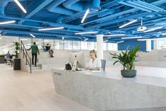This event space also acts as a reception area/front of the house. The clients blue brand colour has been painted on the exposed pipework ceiling, whilst the neutral furniture and flooring balances and softens the contrast. Exposed Ceilings, Blue Ceilings, Corporate Interiors, Office Interiors, Interior Office, Open Ceiling, Office Reception, New London, Coworking Space